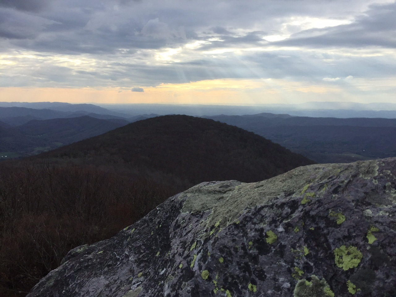 The sun behind the clouds on Buzzard Rock