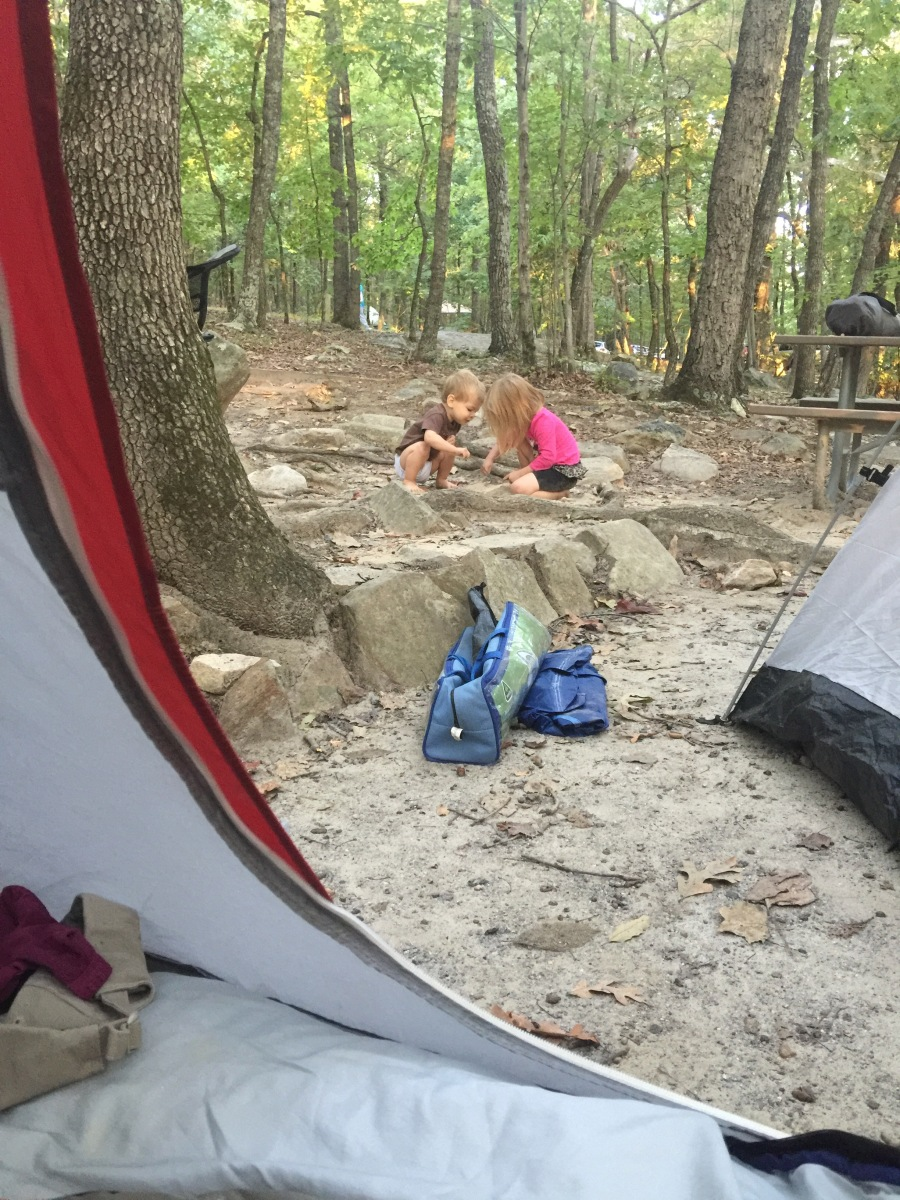 Kids playing in the sand at the campsite