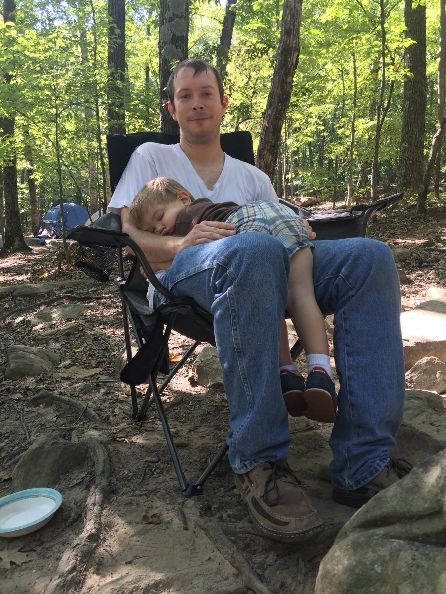 K sleeping on Daddy at the campsite